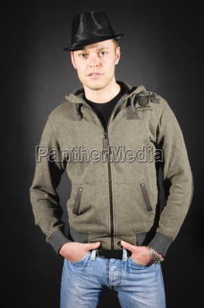 crossed young man in casual clothes