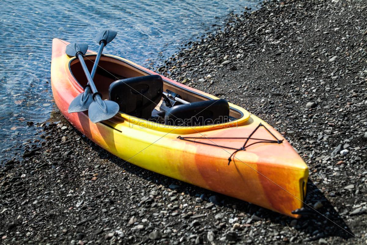 orange, and, yellow, kayak, with, oars - 10223969