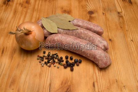 3 bratwuerste on wooden table with
