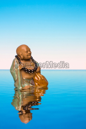 buddha on water in front of