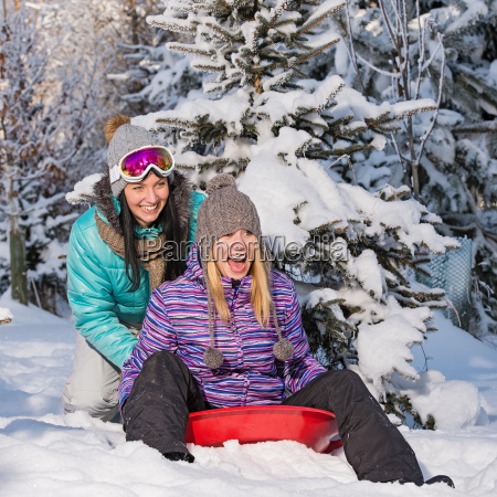 two, female, friends, on, bobsleigh, winter - 10256601