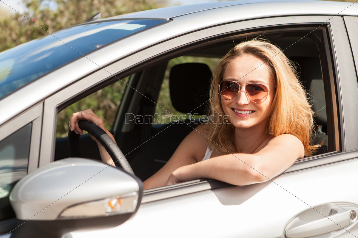 young, laughing, woman, in, car, window - 10291541