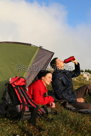 young couple with tent in the