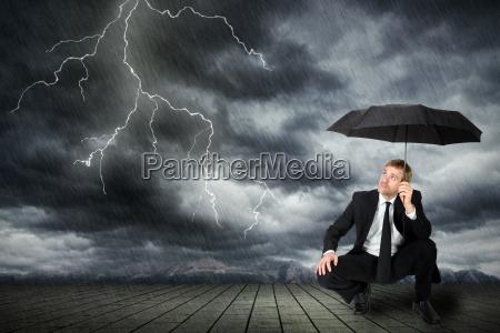 man in suit and umbrella seeks