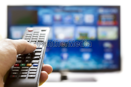 smart tv and hand pressing remote