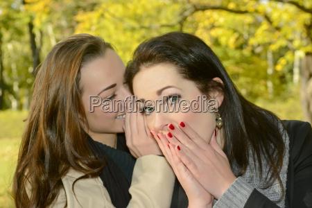 whispering girlfriends