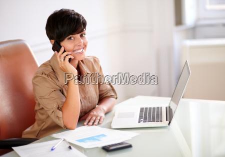 entrepreneur lady speaking on her cellphone