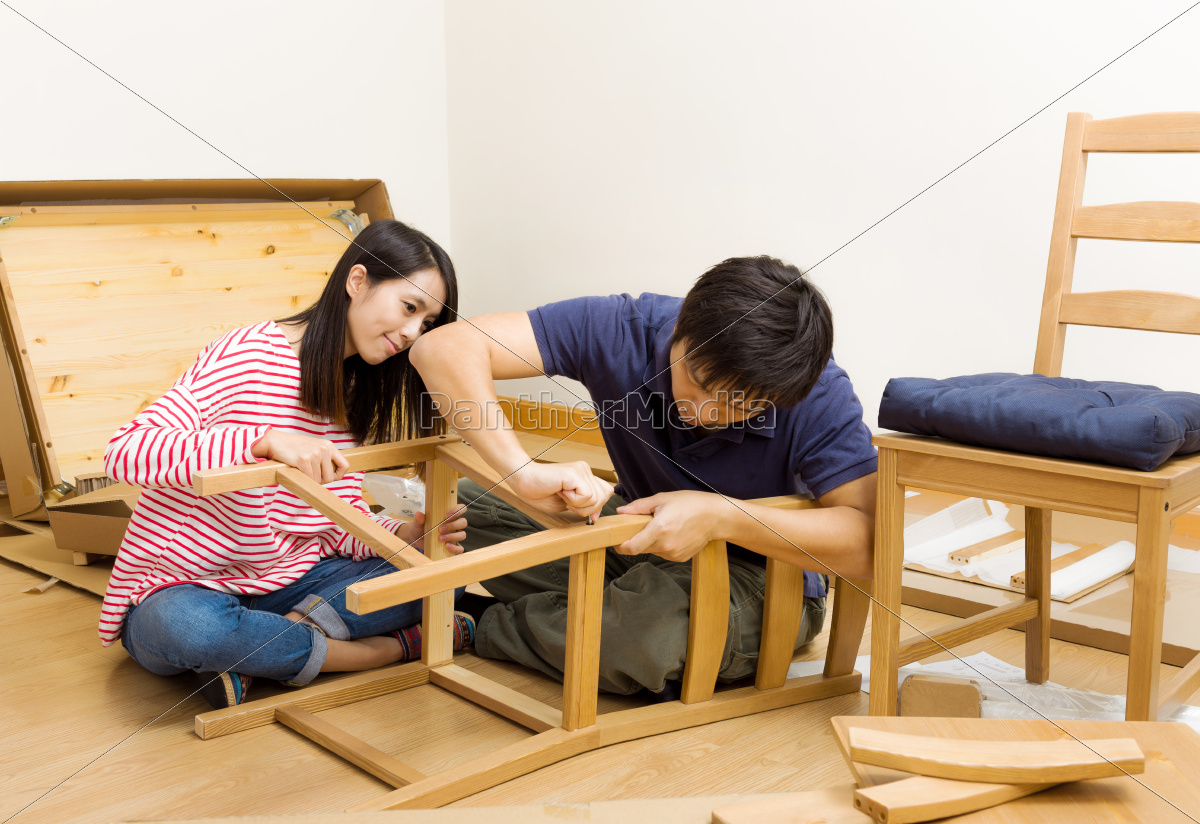 asian, couple, assembling, new, chair - 10414103