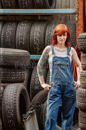 sexy redhead mechanic with tattoos