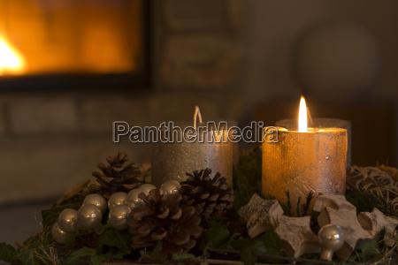 burning candle on christmas wreath