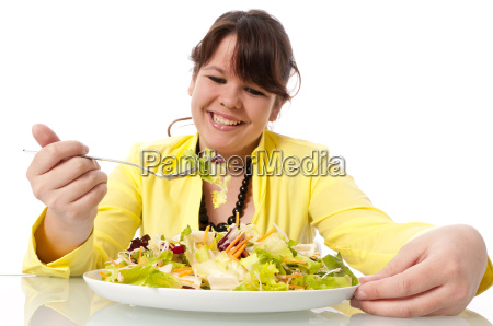 preteen girl with salad plate