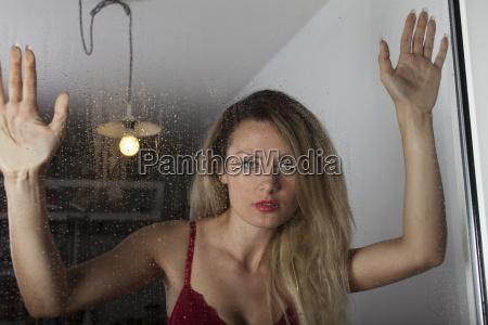 woman in lingerie by a window