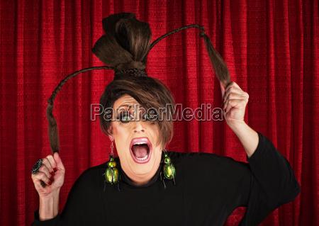 screaming drag queen pulling hair