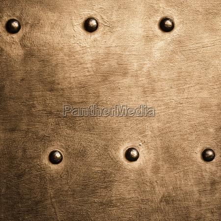 grunge gold brown metal plate rivets