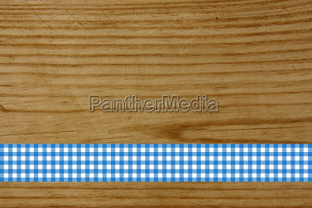 wooden board with blue and white
