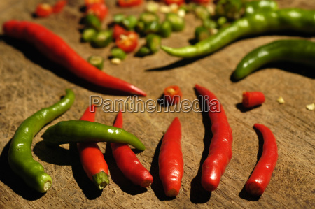 chili peppers on a wooden board