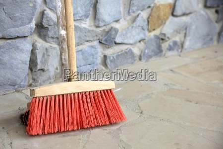 large broom on wall outdoor