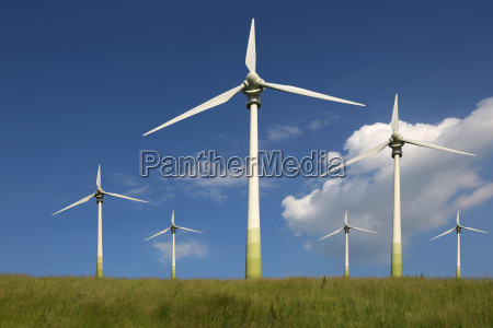 windmills in a meadow on energy