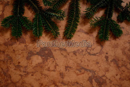 red marble with fir branches
