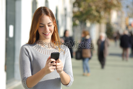 woman in the street browsing a