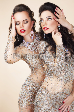 two glamorous women in evening dresses