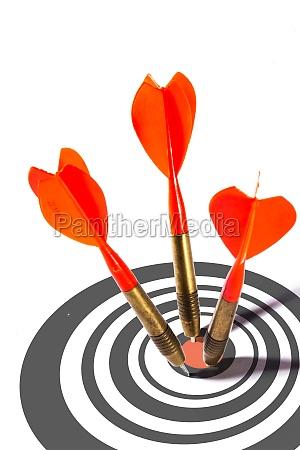 three red darts in a dart