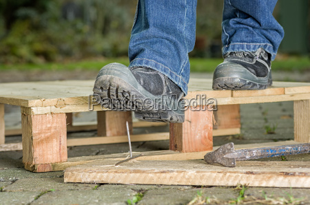 worker with safety shoes steps into