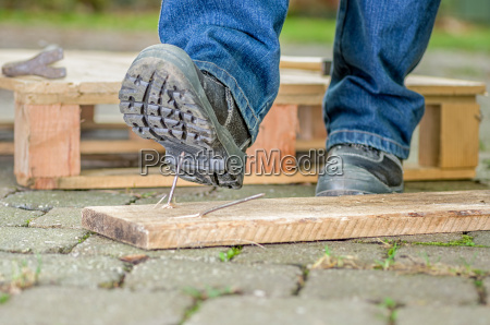 worker with safety shoes enters a