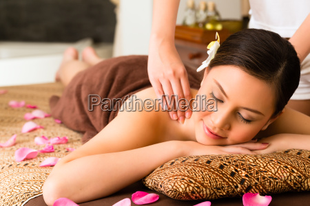 chinese woman at wellness massage with
