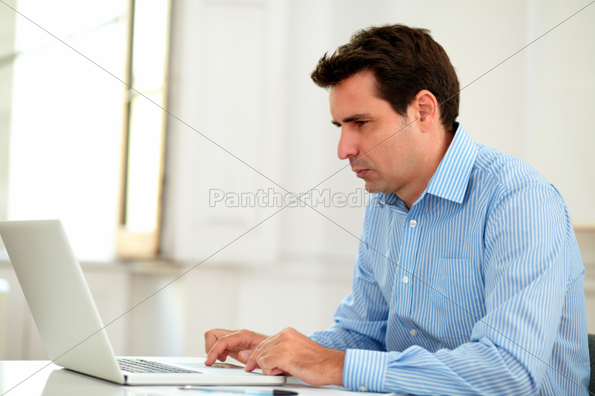 Stock Photo 10628087 Handsome 30s Businessman Working With His Laptop