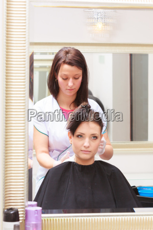 woman dying hair in hairdressing beauty