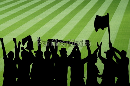 silhouette of cheering football fans