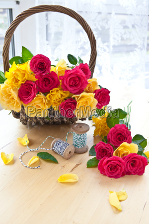 colorful roses in basket
