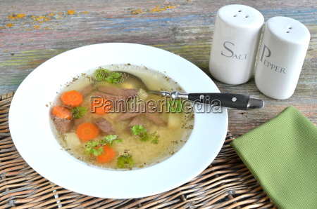 soup with noodles and beef