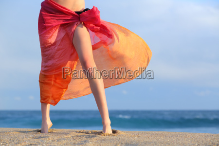 woman legs on vacations posing on