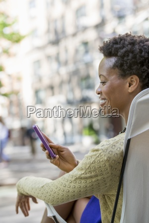 city life a woman sitting in