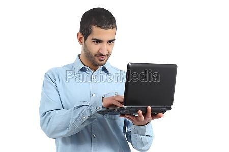 arab casual man browsing a laptop