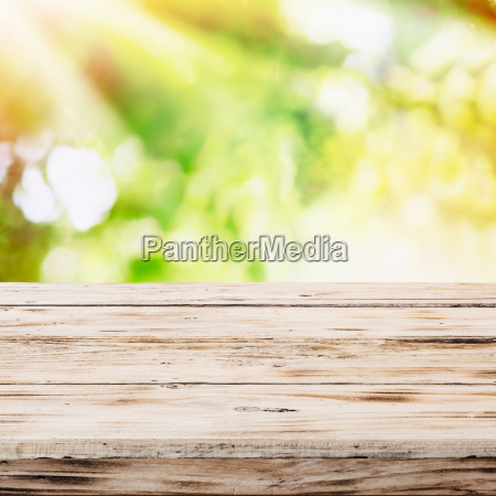 empty rustic wooden table with golden