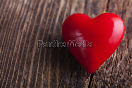 red heart on rough wood