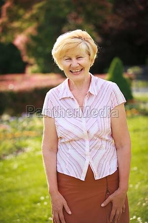 elegance elation happy senior woman outside