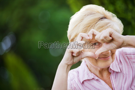 positivity happy funny senior woman showing