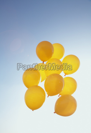 yellow balloons in the blue sky