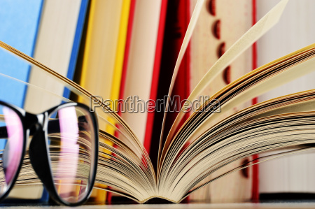 composition with glasses and books on