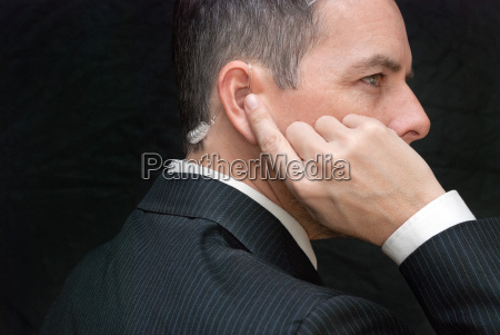 secret service agent listens to earpiece