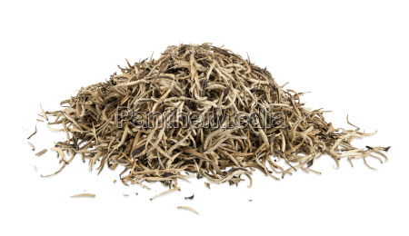 heap of golden ceylon tea leaves