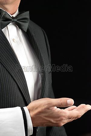fine dining waiter open hand side
