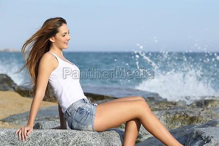 beautiful woman enjoying the wind on