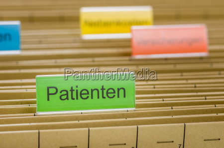 hanging folders with the inscription patients