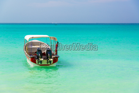 turquoise water and boat