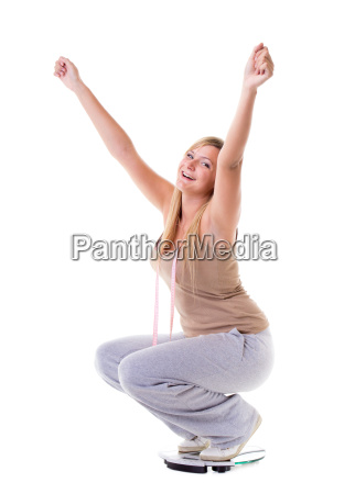 woman plus size on scale celebrating